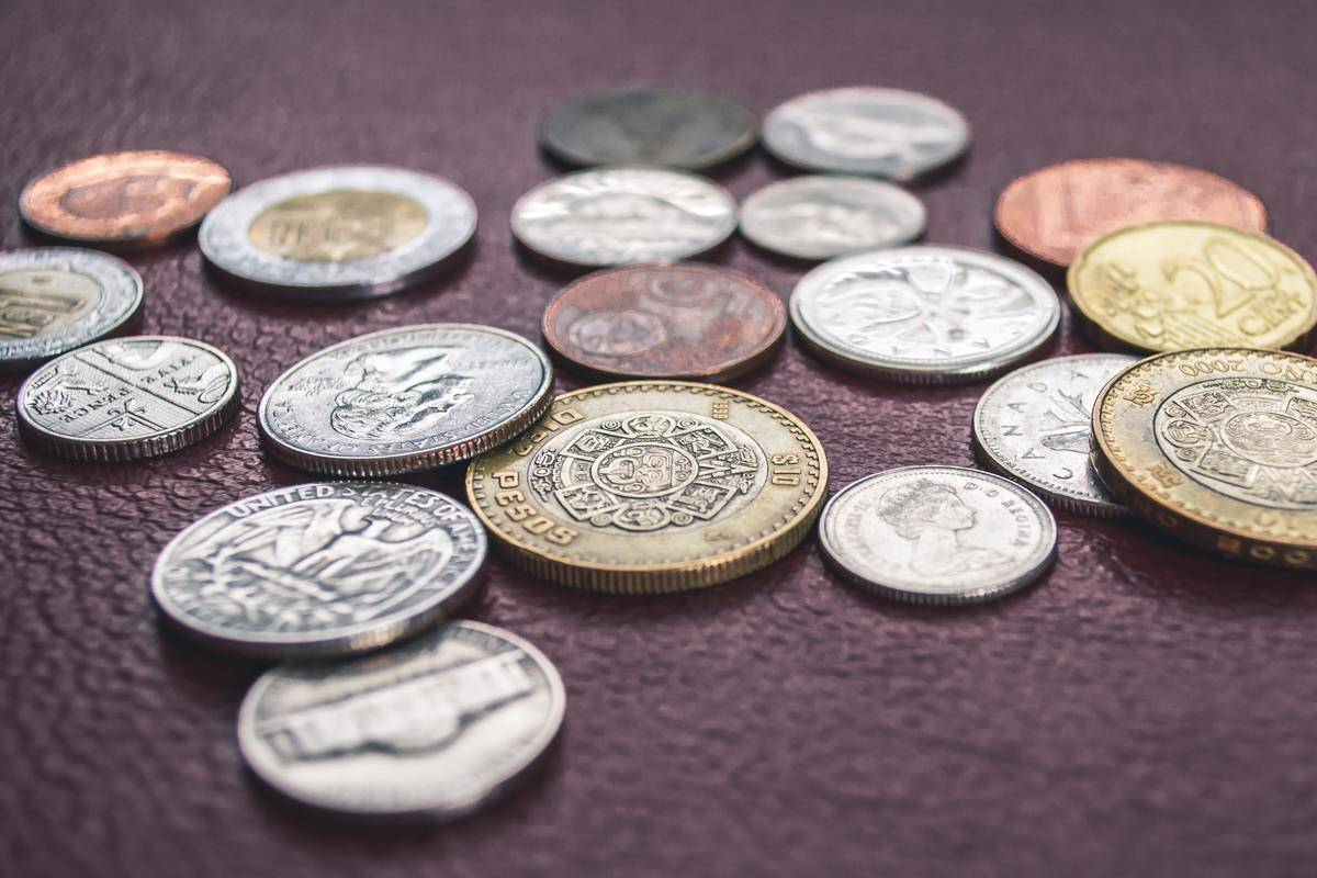 coins from different places on table