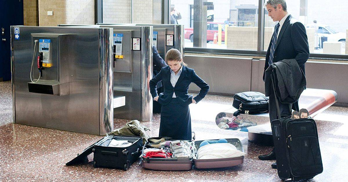 open suitcase in an airport