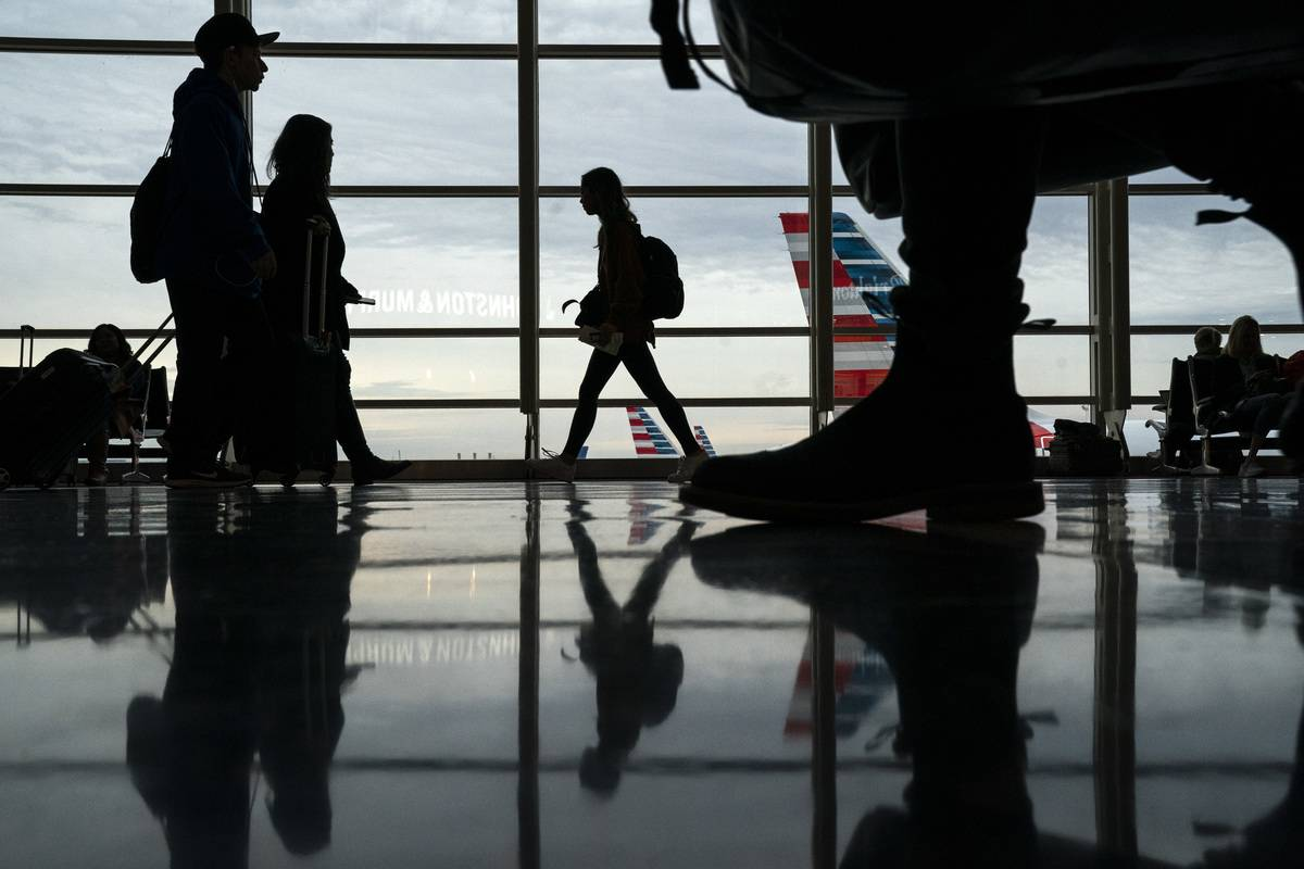 Passengers move through Ronald Reagan National Airport