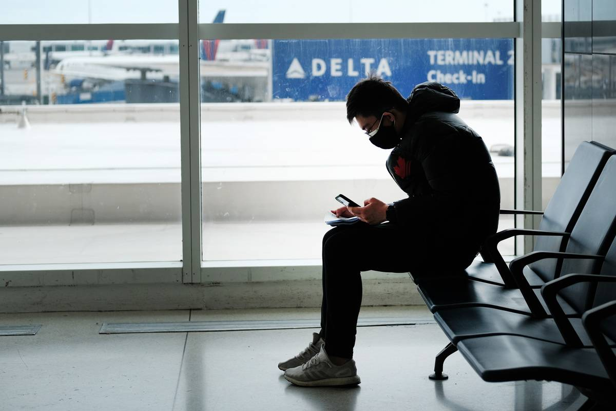 man sitting at airport gate