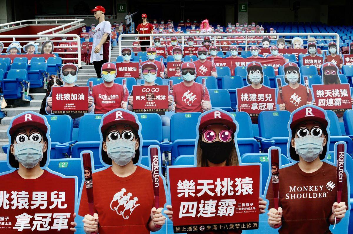 Life-size cutouts depicting a crowd of spectators are seen placed in empty seating during a Chinese Professional Baseball League (CPBL)