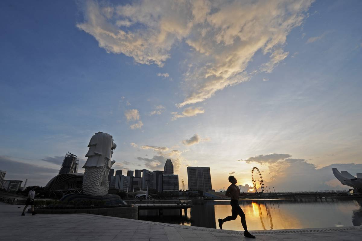 A person runs in the morning through Singapore.