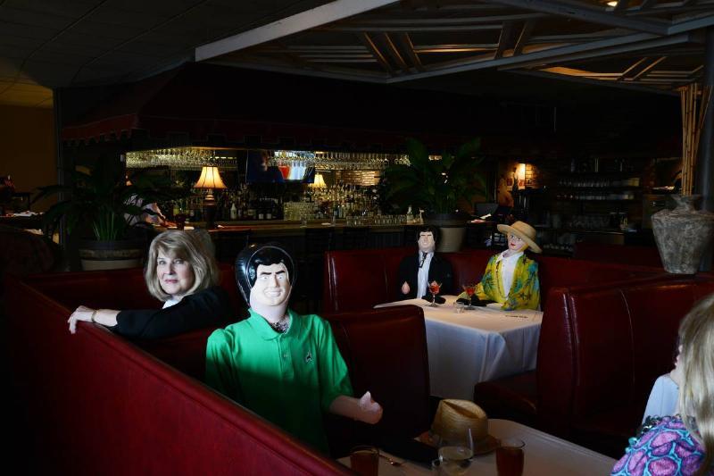blow-up dolls in restaurant booths