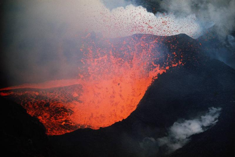 Red hot lava spews from an erupting volcano on Surtsey,