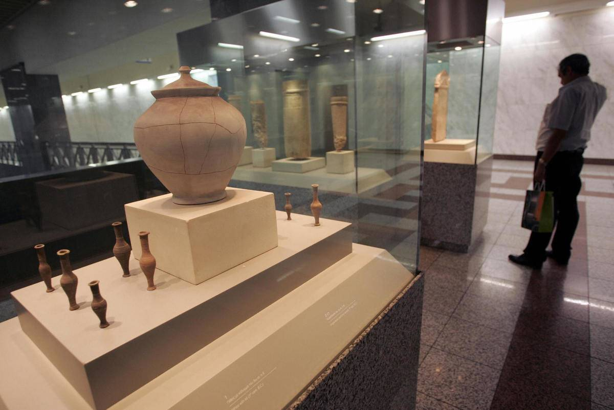 A man looks at ancient Greek pottery showcased at the Syntagma station.