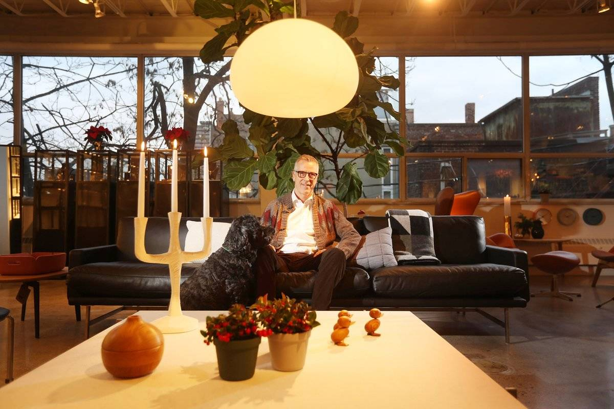 A Danish furniture store owner exemplifies hygge, the concept of coziness in interior design.