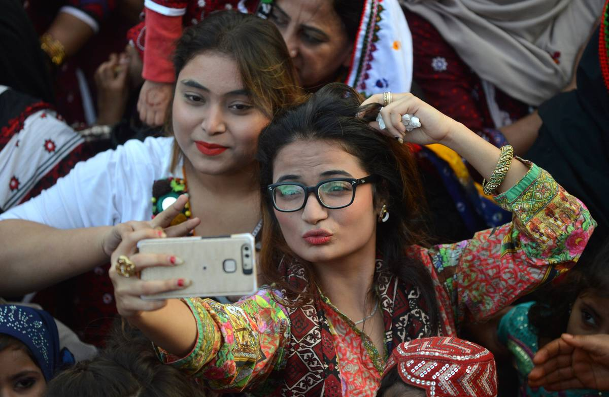 Sindhi women take selfies during Sindhi Culture Day.