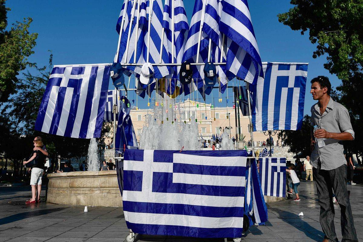 A vendor sells Greek flags in Athens.