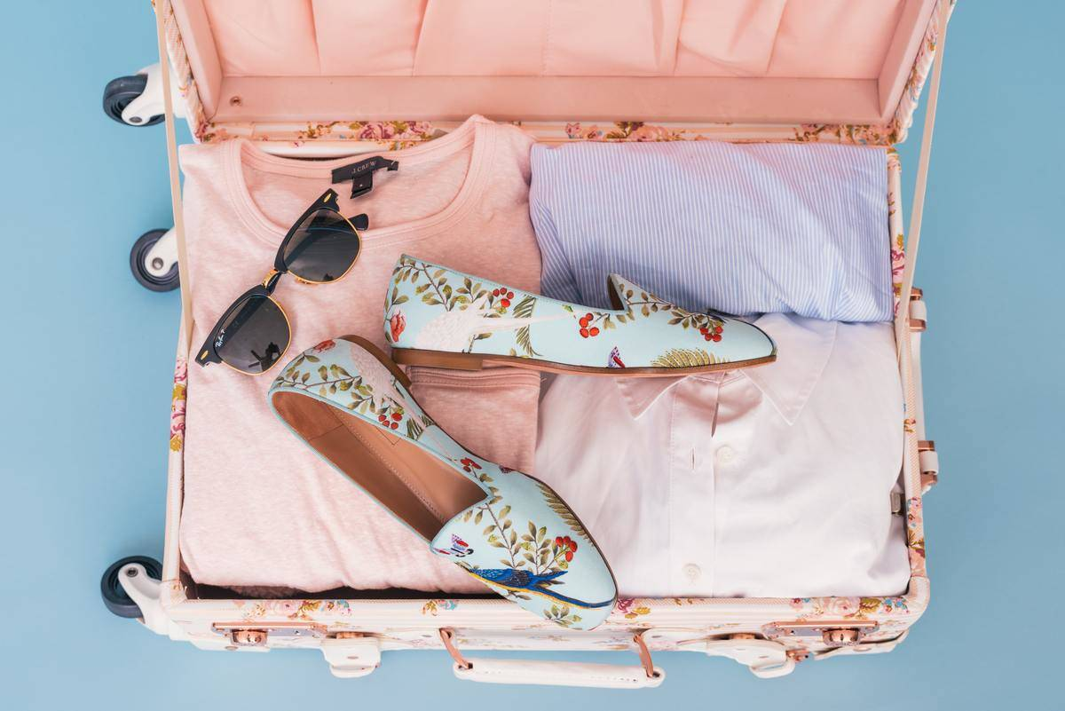 shoes in person's suitcase