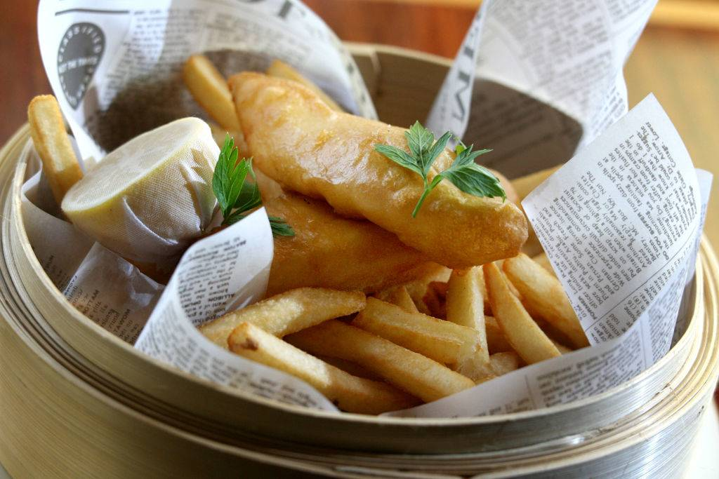 fried fish and french fries in a basket
