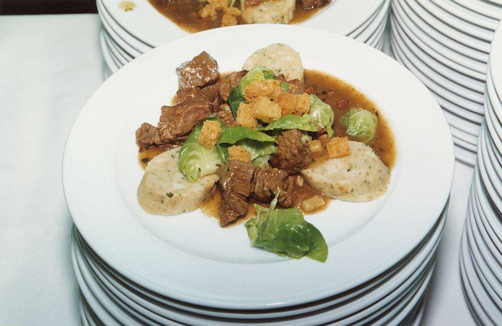 goulash with meat, lettuce, croutons, and potatoes
