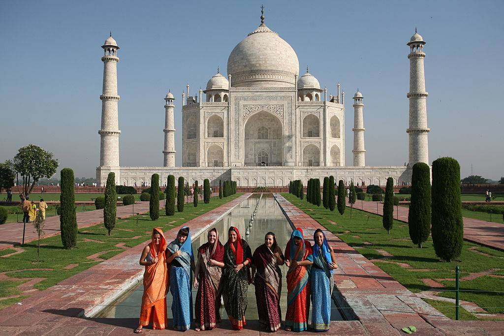 Indian tourists pose for a photo at the Taj Mahal