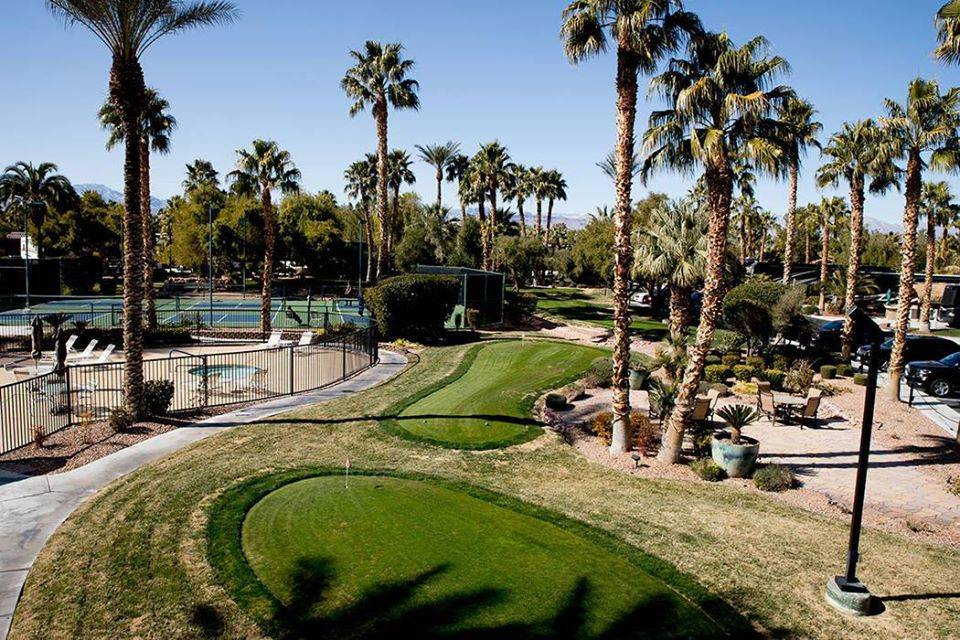 a golf course and tennis court surrounded by palm trees