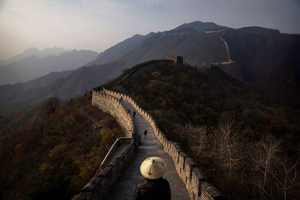 Chinese and foreign toursits walk on a section of the Great Wall of China