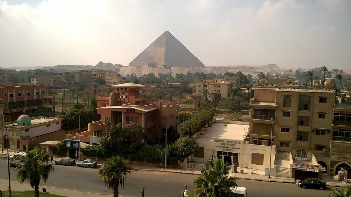 giza pyramids from city