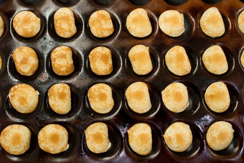 poffertjes inside a baking pan