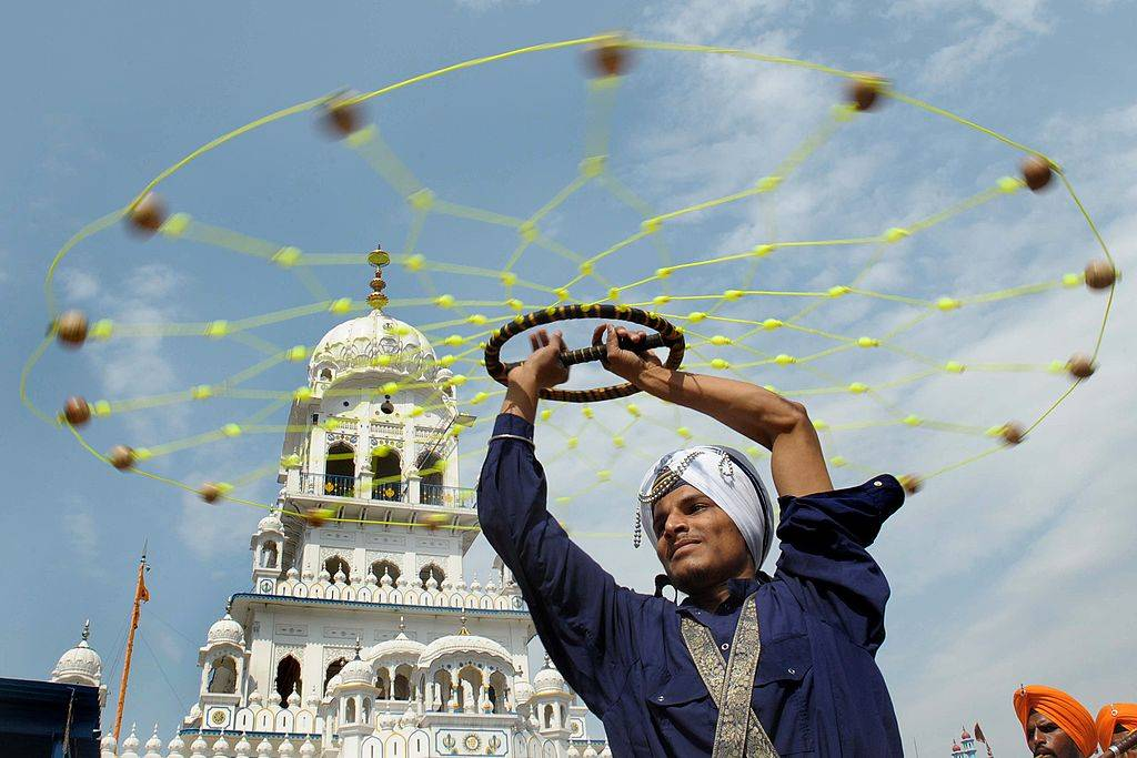An Indian Nihang - religious Sikh warrior - shows off his skills in the Sikh martial art known as Gatka