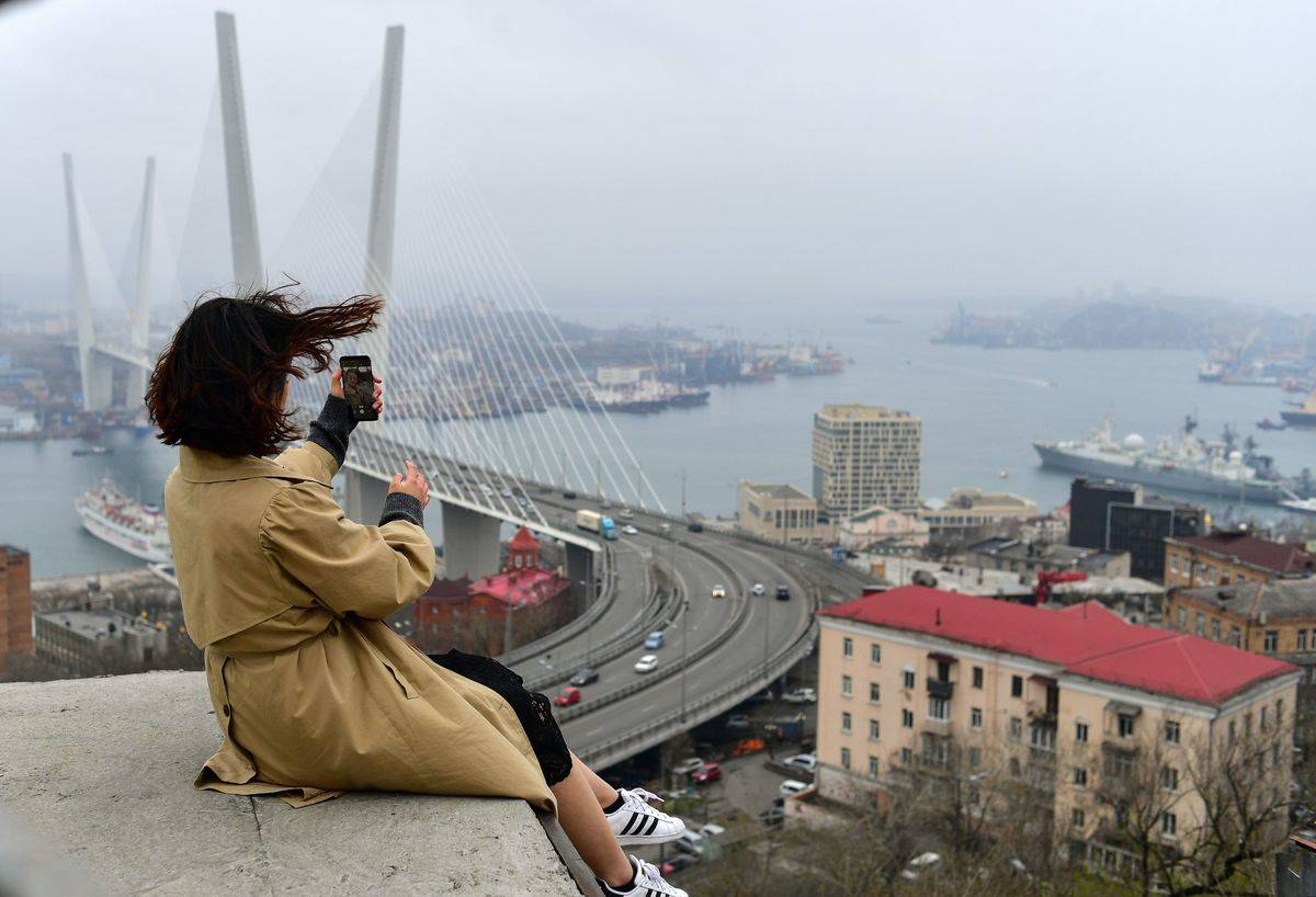 People enjoy the view from an observation point in the far-eastern Russian port of Vladivostok