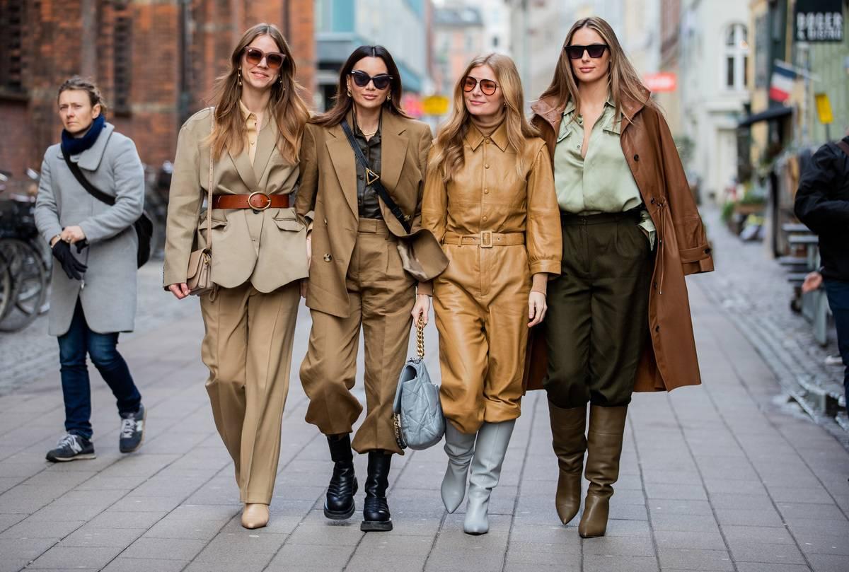 women in fashionable outfits walking on copenhagen sidewalk
