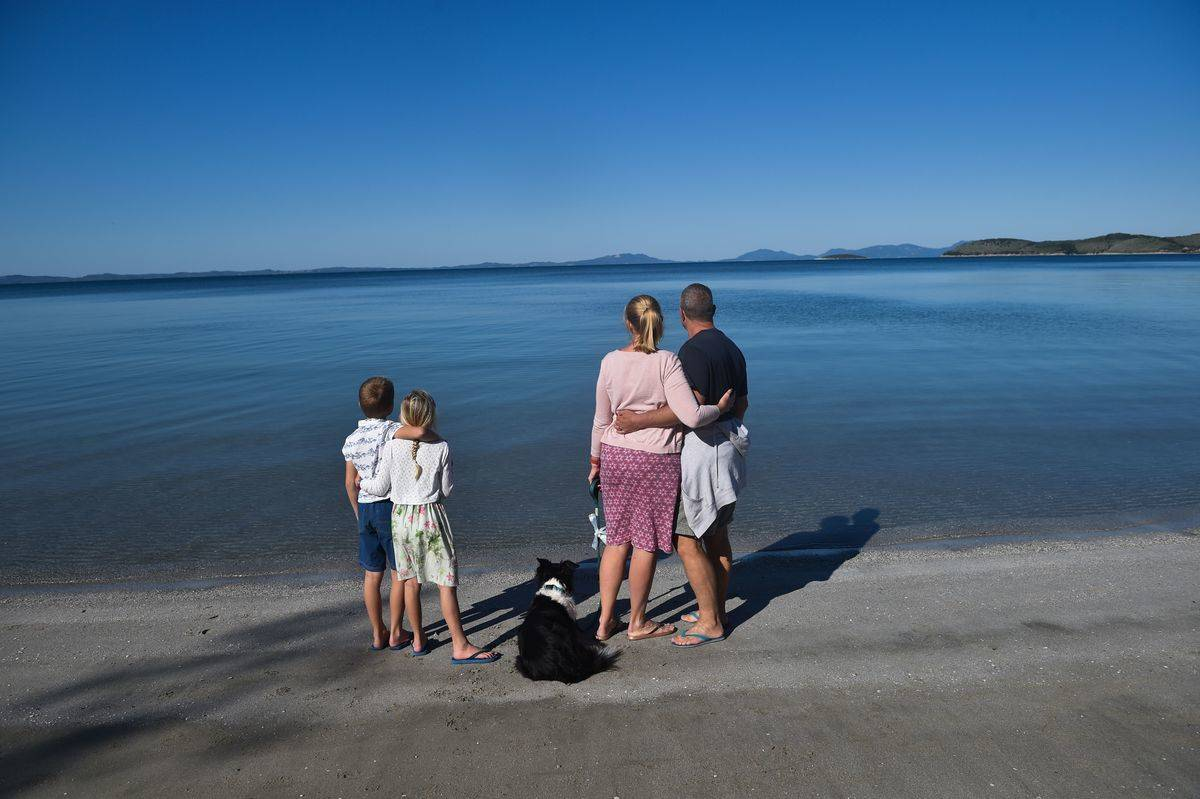 A family from England watch the sea