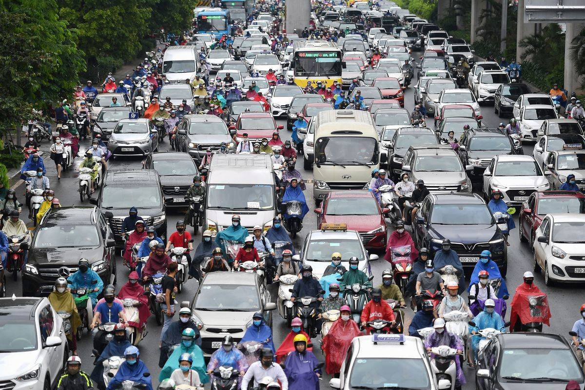 Motorists are pictured in morning rush hour traffic on a congested road in Hanoi