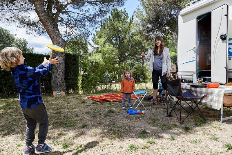 A family enjoys a weekend with their motorhome at the Monte Holiday campsite