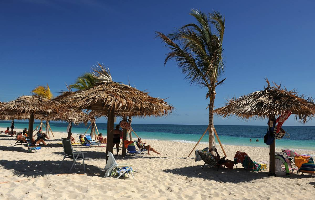 Beachgoers soak up sunshine at Coral Beach.