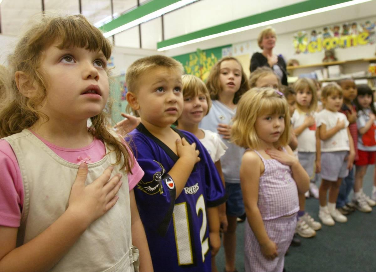 kindergarten class at school recite the Pledge of Allegiance