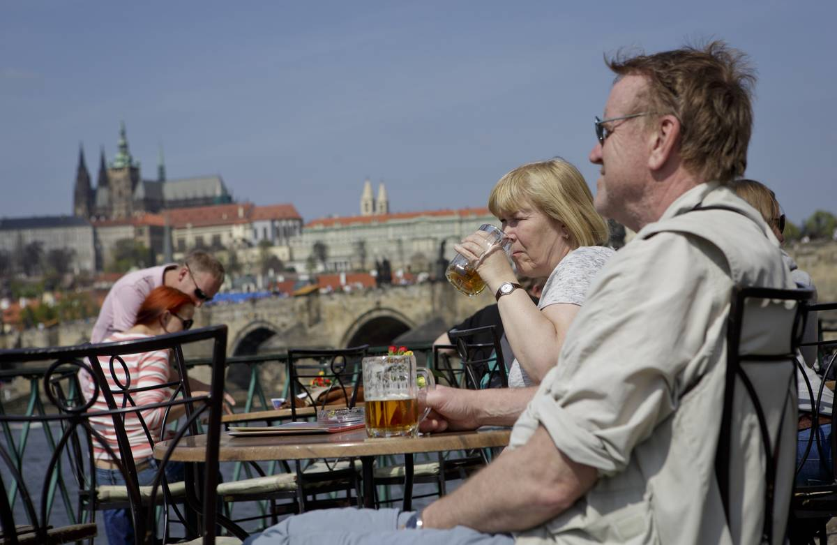 tourist drinks beer at the garden of