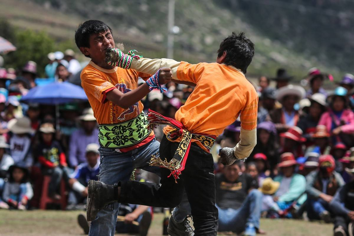 Two men fight during Takanakuy celebrations