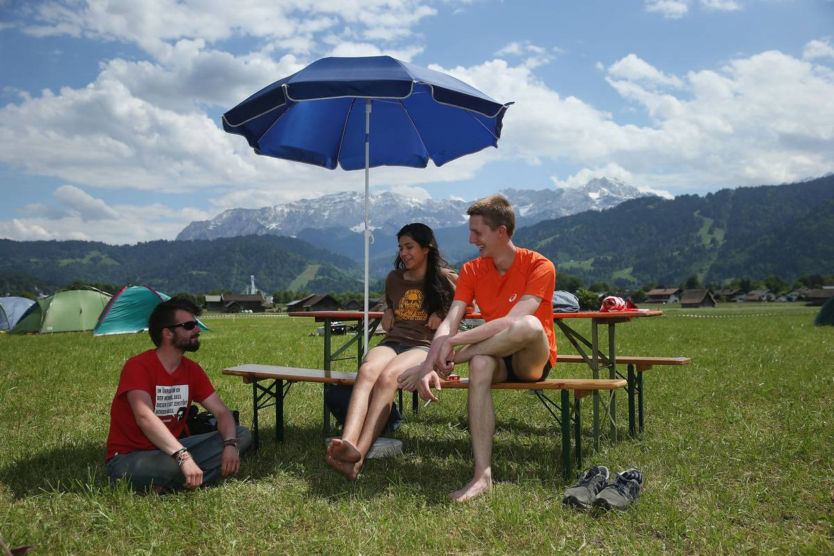 young people sitting together at campsite
