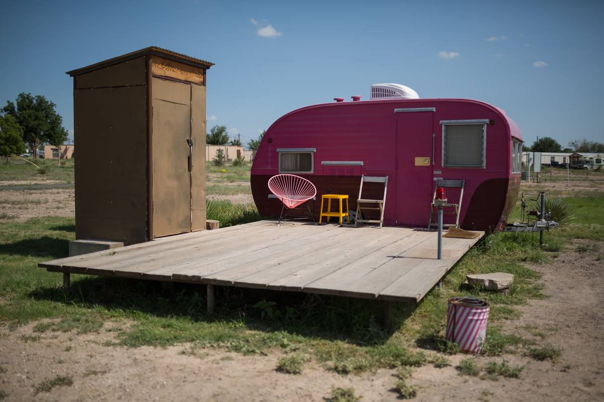Cute pink camping trailer with an outdoor bathroom