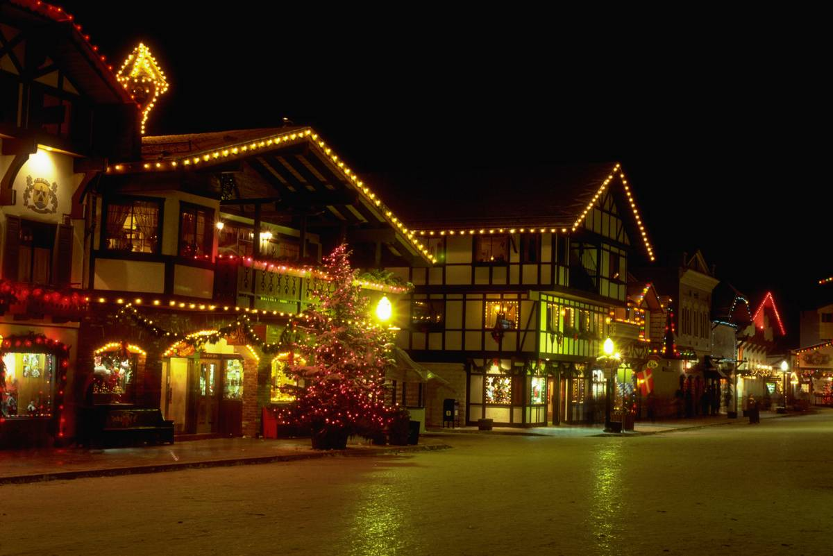 Swiss-style buildings which look like chalets, are lit up with colored lights at Christmastime