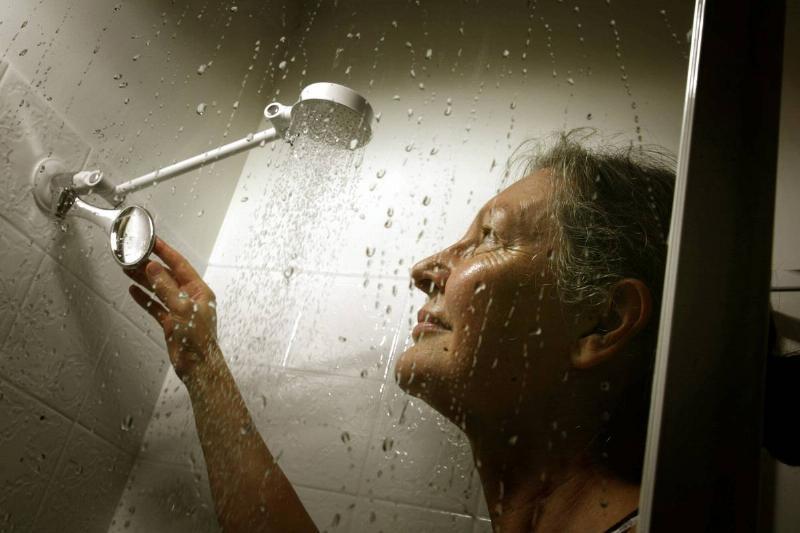 woman under shower head