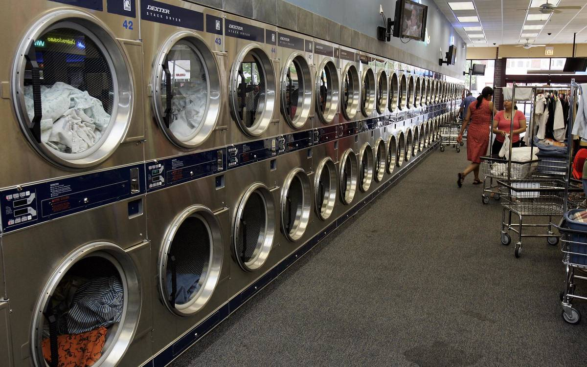 A long row of laundry dryers