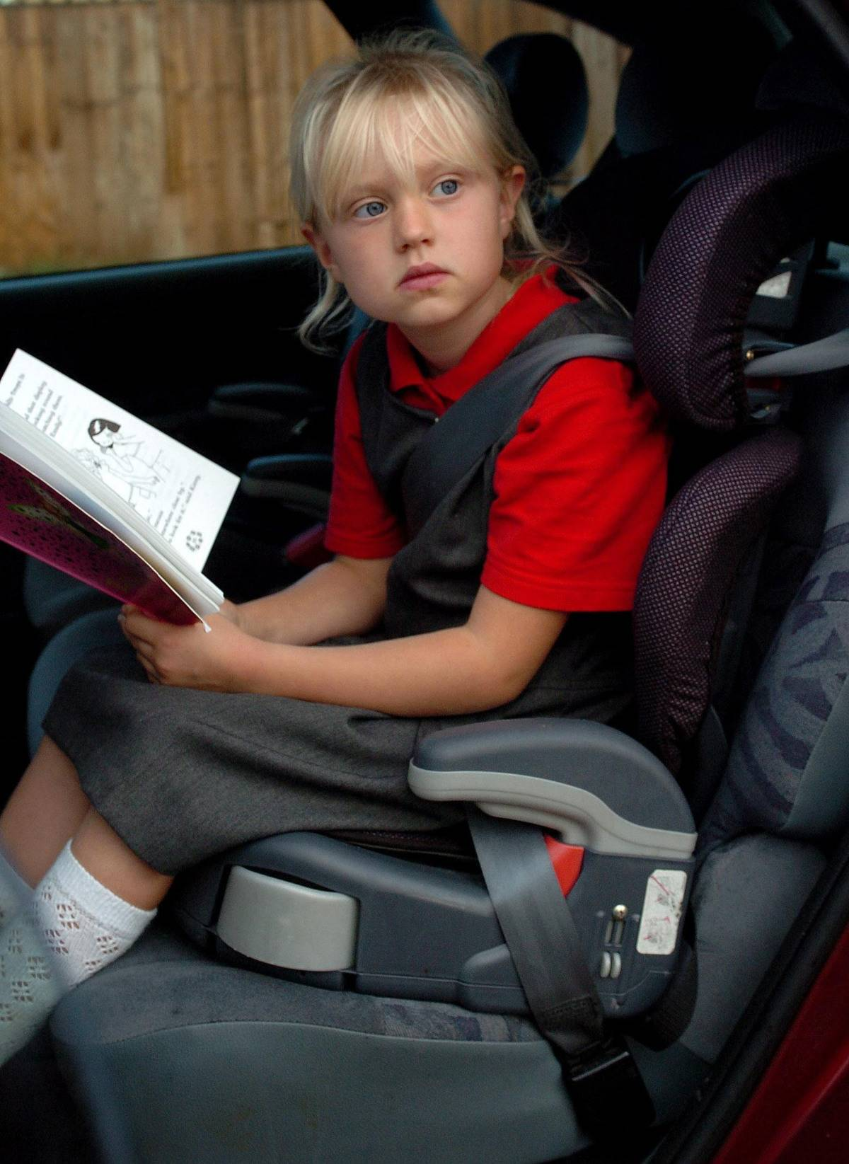 seven-year-old girl using a car seat