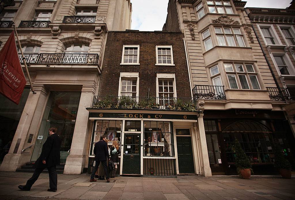 the exterior of lock & co. hatters in old english-style buildings