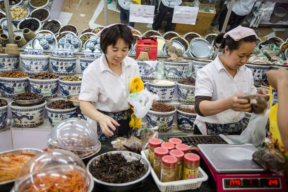 women packing food at the lubiju pickle and sauce shop in china