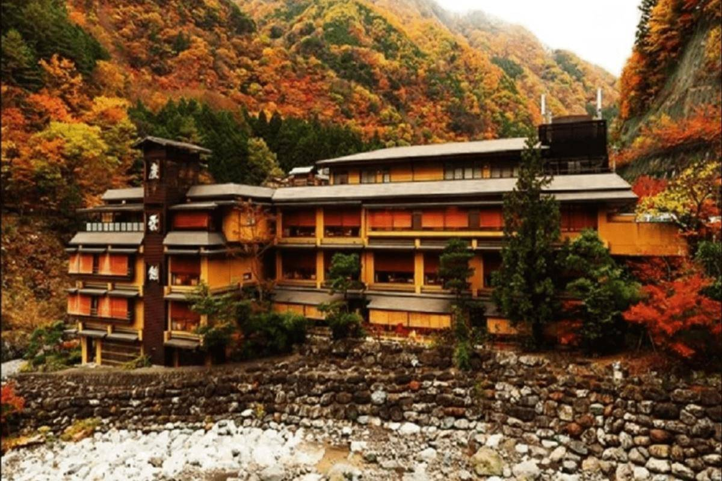 the exterior of the nishiyama onsen keiunkan hotel during autumn
