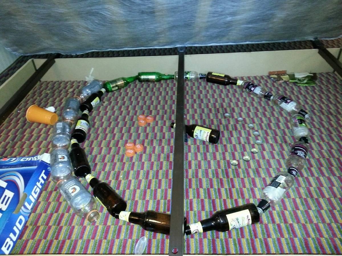 bottles arranged under mattress