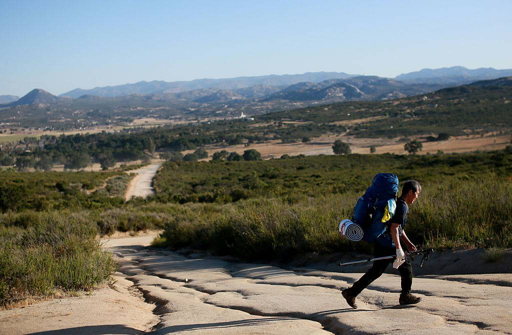 a backpacker walking along the pacific crest trail