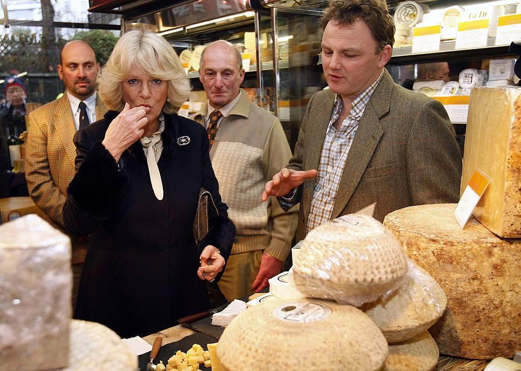 camilla, duchess of cornwall eating cheese at paxton & whitfield