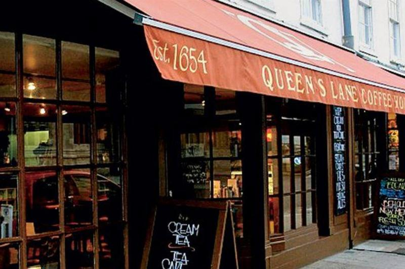 the outdoor area of a coffee shop called queen's lane