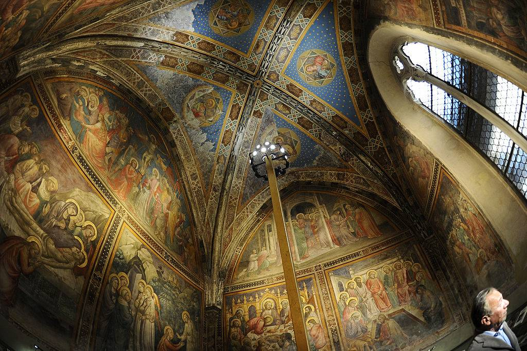 the painted murals on the walls and ceilings of the santa maria novella pharmacy