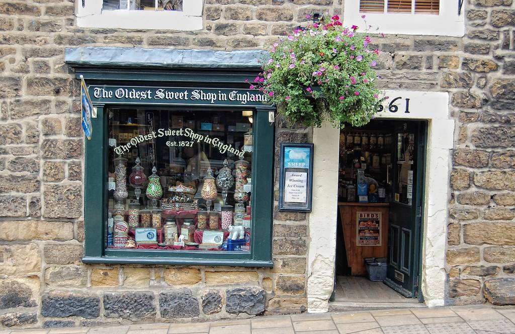 the exterior of the oldest sweet shop in england with a pale brick wall