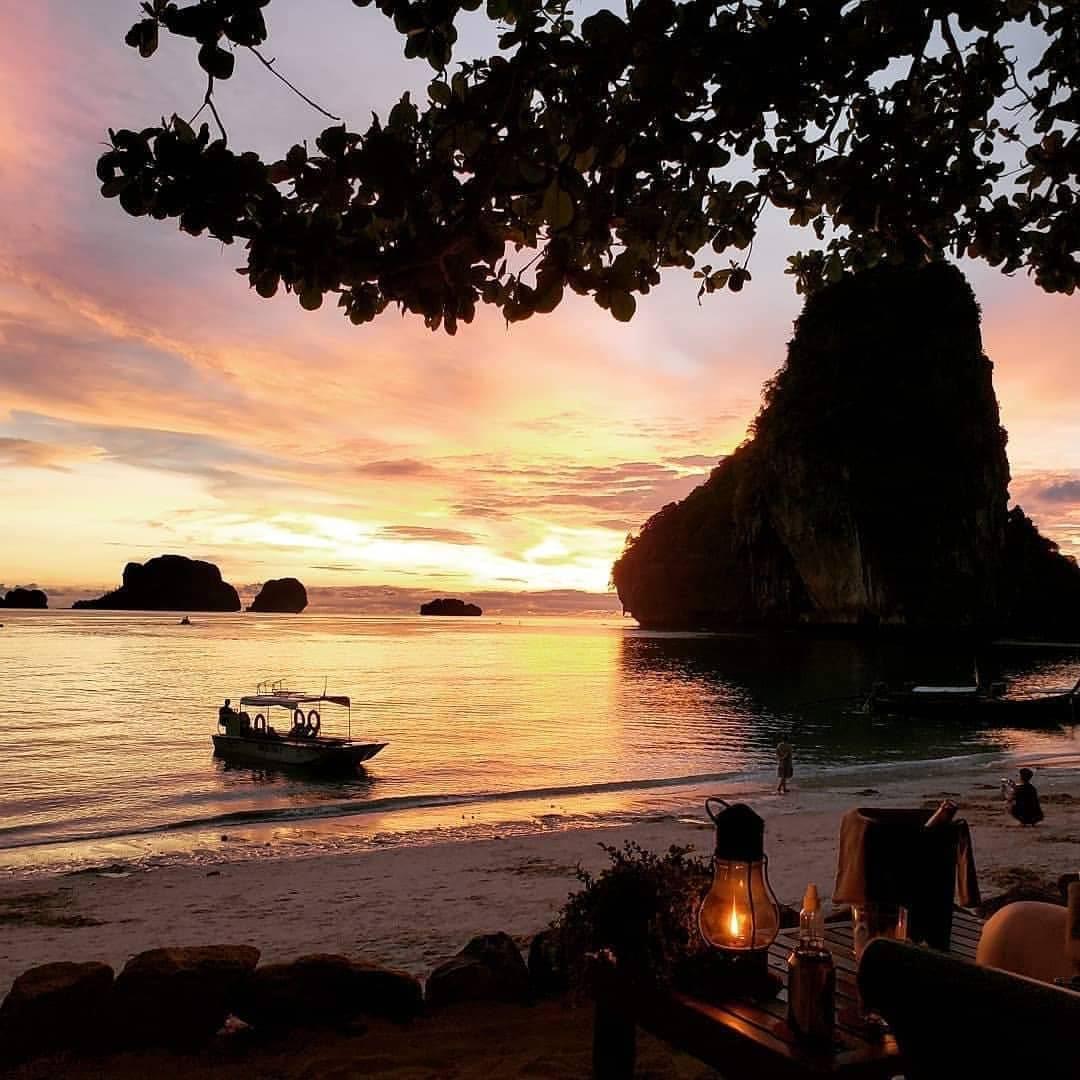 restaurant tables on beach overlook sunset on water