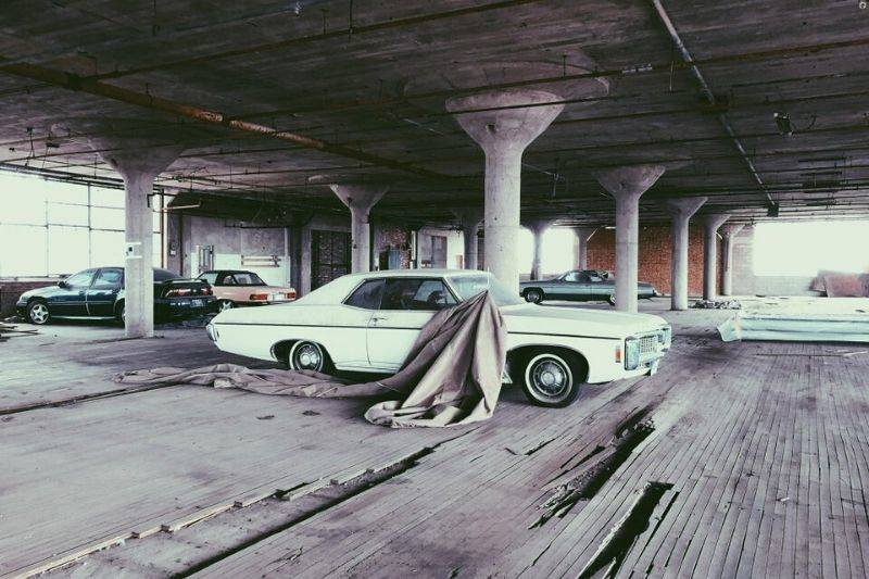 old cars in a parking garage