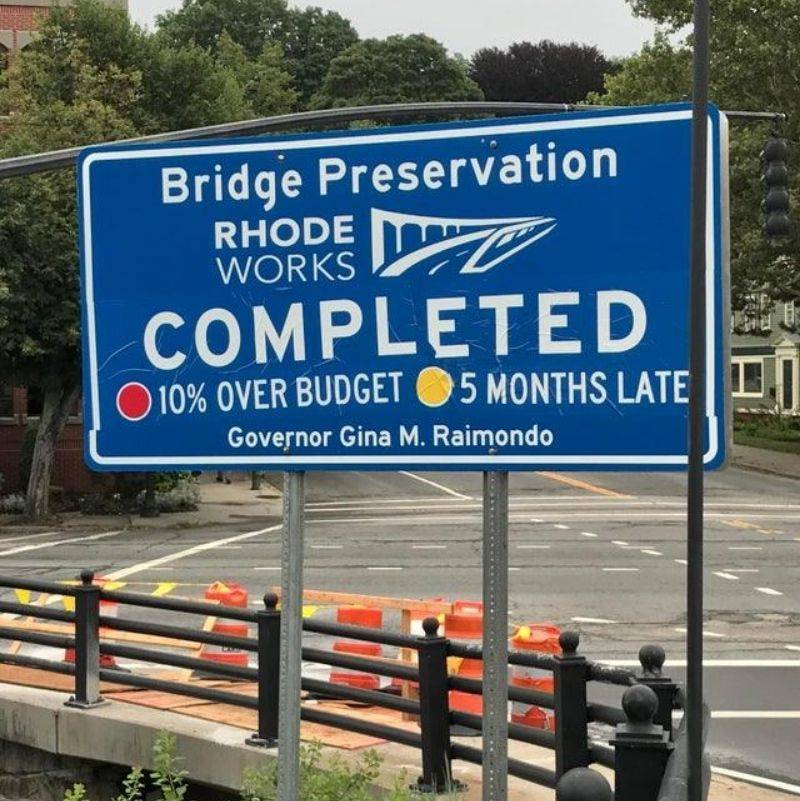 a sign letting you know how behind and over budget a construction project is