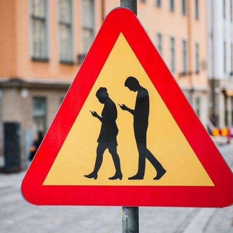 a sign alerting you to people on their phones