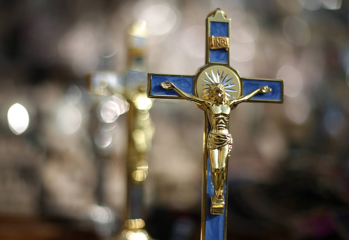 Crucifixes are displayed for sale near Vatican City